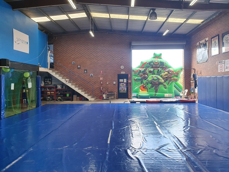 Our large wrestling mat ajoining a kids jumping castle